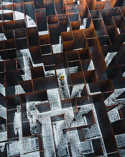 Aerial view of a man walking in a maze