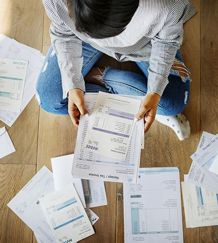 Person Sitting on the Floor Surrounded by Bills and Documents - Tax Problems - Tax Debt